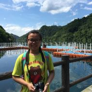 a young woman (Sarah Feng) in front of a lake